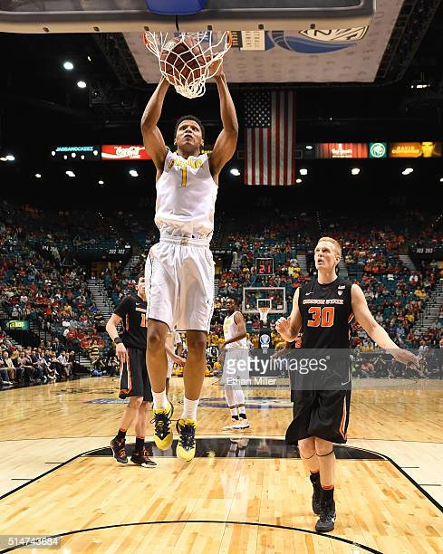 Ivan Rabb of the California Golden Bears dunks ahead of Olaf Schaftenaar of the Oregon State Beavers during a quarterfinal game of the Pac12...