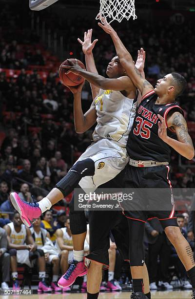 Ivan Rabb of the California Golden Bears goes for the basket between Jakob Poeltl and Kyle Kuzma of the Utah Utes in the second half of the Utes 7364...