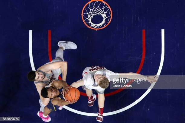 Ivan Rabb of the California Golden Bears grabs a rebound over Dusan Ristic of the Arizona Wildcats and Lauri Markkanen during the second half of the...