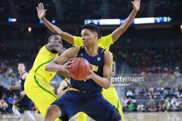 Ivan Rabb of the California Golden Bears handles the ball against Chris Boucher of the Oregon Ducks during a semifinal game of the Pac12 Basketball...