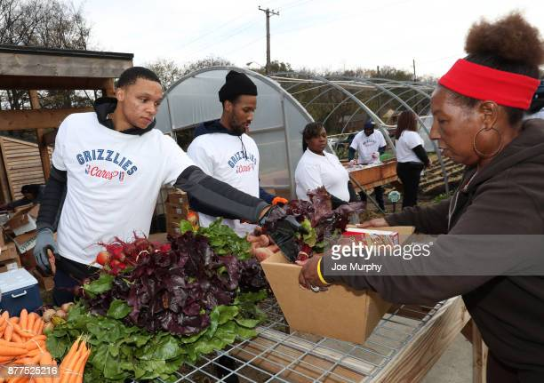 Ivan Rabb of the Memphis Grizzlies participates in a Thanksgiving giveaway on November 21 2017 at Green Leaf Learning Farm in Memphis Tennessee NOTE...