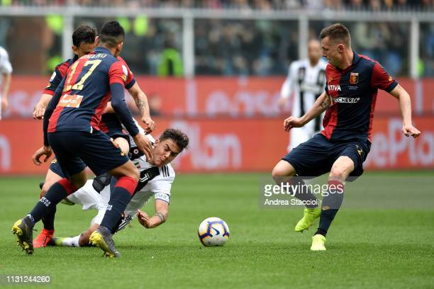 Ivan Radovanovic Cristian Romero and Pedro Pereira of Genoa Paulo Dybala of Juventus compete for the ball during the Serie A match between Genoa CFC...