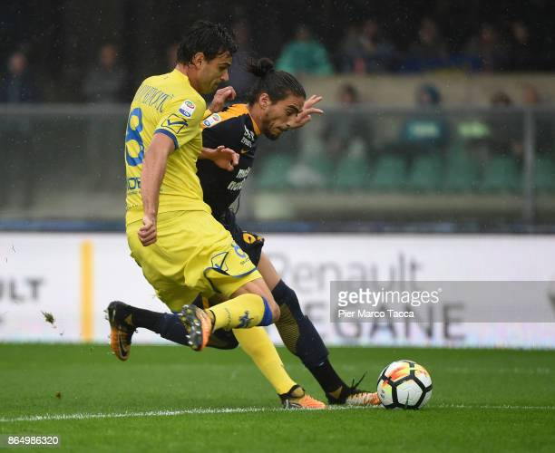 Ivan Radovanovic of AC Chievo Verona competes for the ball with Martin Caceres of Hellas Verona during the Serie A match between AC Chievo Verona and...
