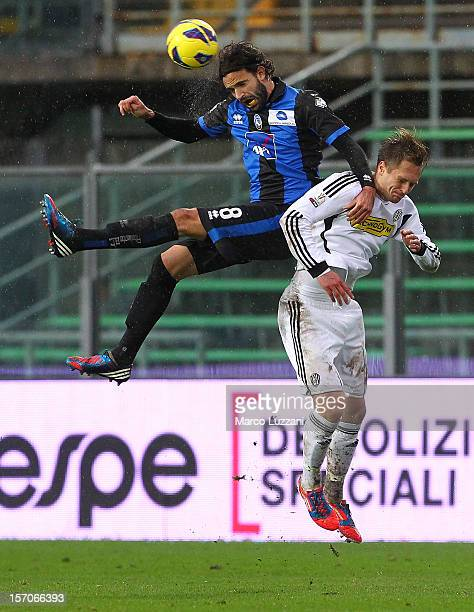 Ivan Radovanovic of Atalanta BC competes for the ball with Damjan Djokovic of AC Cesena during the TIM Cup match between Atalanta BC and AC Cesena at...