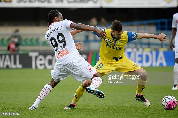 Ivan Radovanovic of Chievo Verona competes with Jerry Mbakogu of Carpi FC during the Serie A match between AC Chievo Verona and Carpi FC at Stadio...