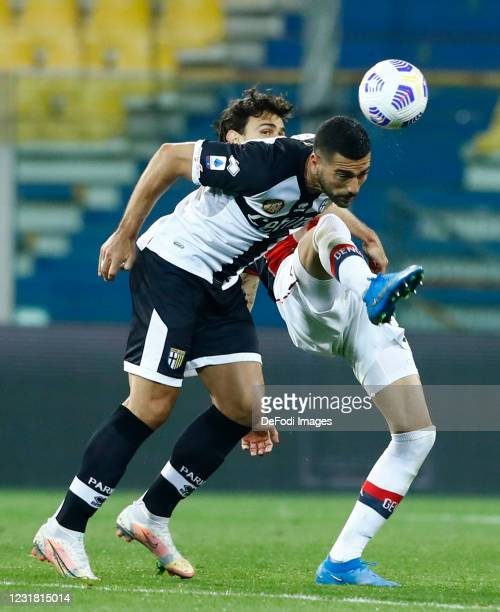 Ivan Radovanovic of Genoa and Graziano Pelle of Parma Calcio battle for the ball during the Serie A match between Parma Calcio and Genoa CFC at...
