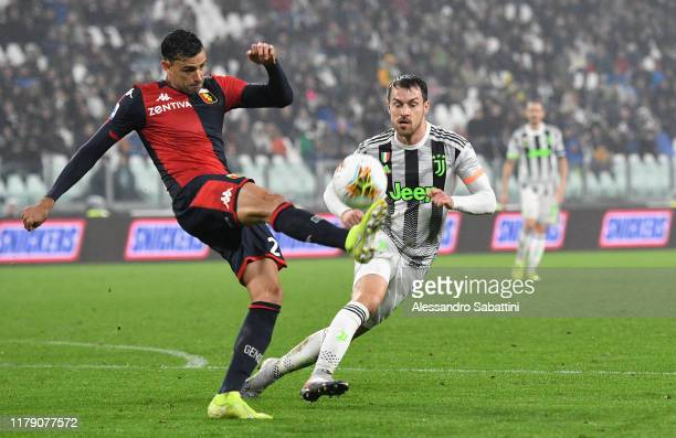 Ivan Radovanovic of Genoa CFC competes for the ball with Aaron Ramsey of Juventus during the Serie A match between Juventus and Genoa CFC at on...