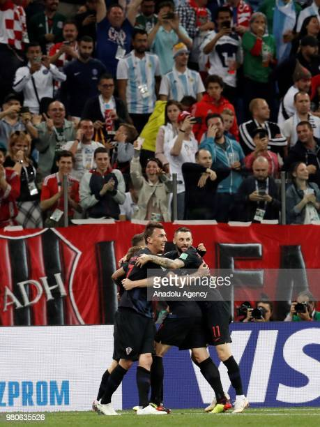 Ivan Rakitic and Marcelo Brozovic of Croatia celebrate with their teammates after winning the 2018 FIFA World Cup Russia Group D match against...