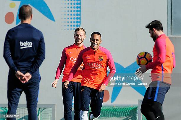 Ivan Rakitic and Neymar Jr take part in a training session at the Sports Center FC Barcelona Joan Gamper before the Spanish League match between FC...