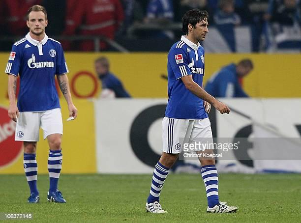 Ivan Rakitic and Raul Gonzalez of Schalke look dejected after losing the Bundesliga match between FC Schalke 04 and Bayer Leverkusen at the Veltins...