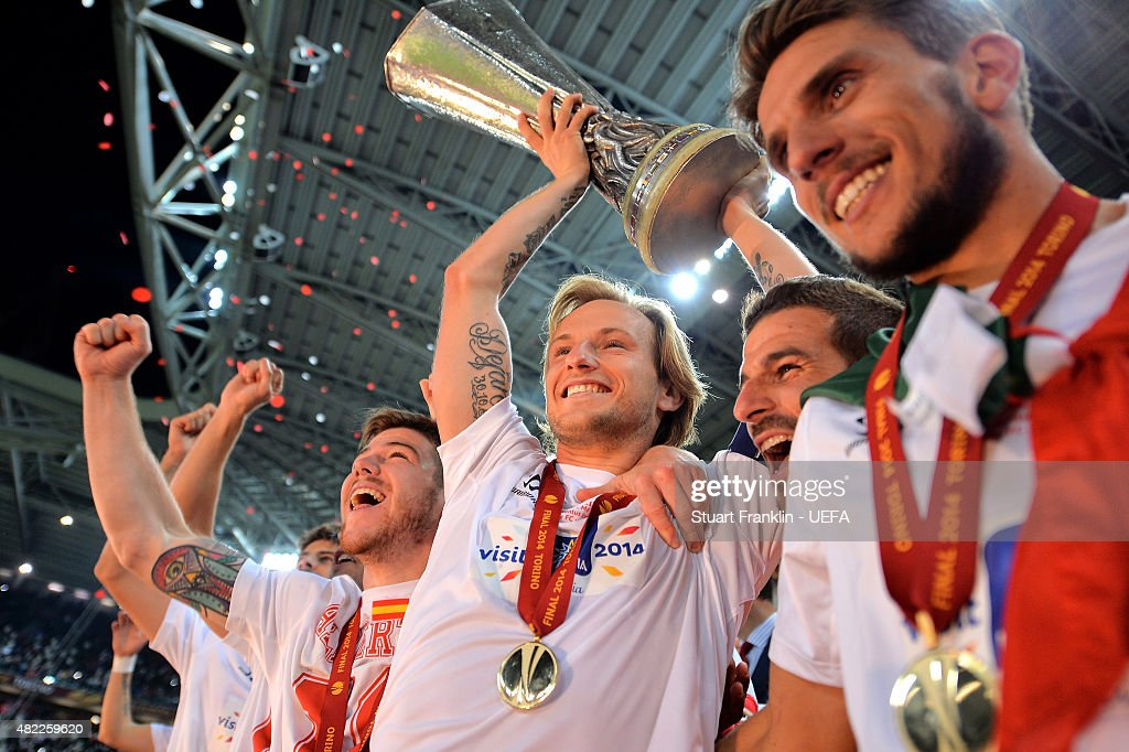 Ivan Rakitic, Captain of Sevilla FC lifts the trophy after victory during the UEFA Europa League Final between Sevilla FC and SL Benfica at Juventus Arena on May 13, 2014 in Turin, Italy.