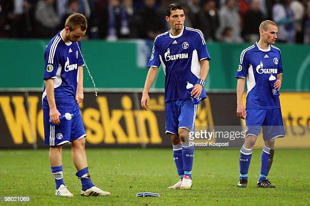 Ivan Rakitic Kevin Kuranyi and Peer Kluge of Schalke look dejected after losing 01 after extra time the DFB Cup semi final match between FC Schalke...