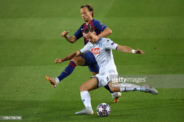 Ivan Rakitic of Barcelona battles for possession with Fabian Ruiz of SSC Napoli during the UEFA Champions League round of 16 second leg match between...