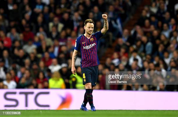 Ivan Rakitic of Barcelona celebrates after scoring his sides first goal during the La Liga match between Real Madrid CF and FC Barcelona at Estadio...
