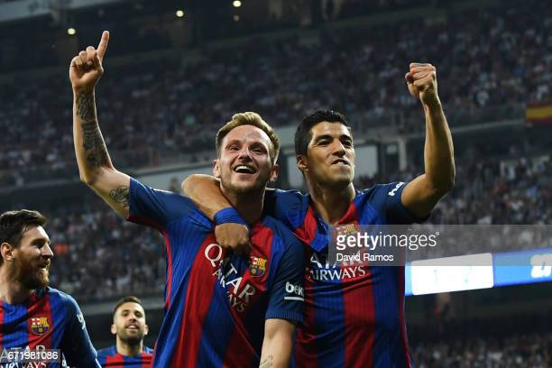 Ivan Rakitic of Barcelona celebrates as he scores their second goal with Luis Suarez and team mates during the La Liga match between Real Madrid CF...