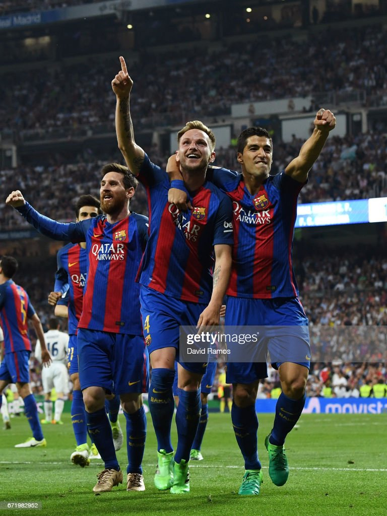 Ivan Rakitic of Barcelona (4) celebrates as he scores their second goal with Luis Suarez (9) and Lionel Messi during the La Liga match between Real Madrid CF and FC Barcelona at Estadio Bernabeu on April 23, 2017 in Madrid, Spain.