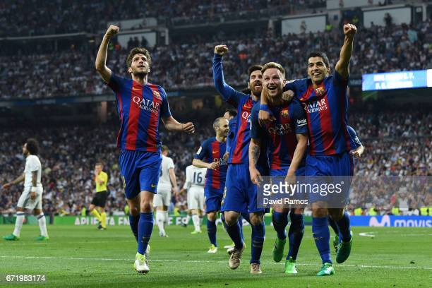 Ivan Rakitic of Barcelona celebrates as he scores their second goal with team mates Sergi Roberto Lionel Messi and Luis Suarez during the La Liga...
