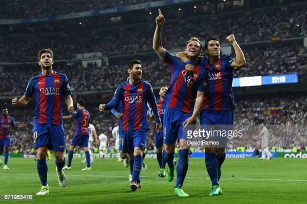 Ivan Rakitic of Barcelona celebrates as he scores their second goal with team mates Sergi Roberto Lionel Messi and Luis Suarez during the La Liga...