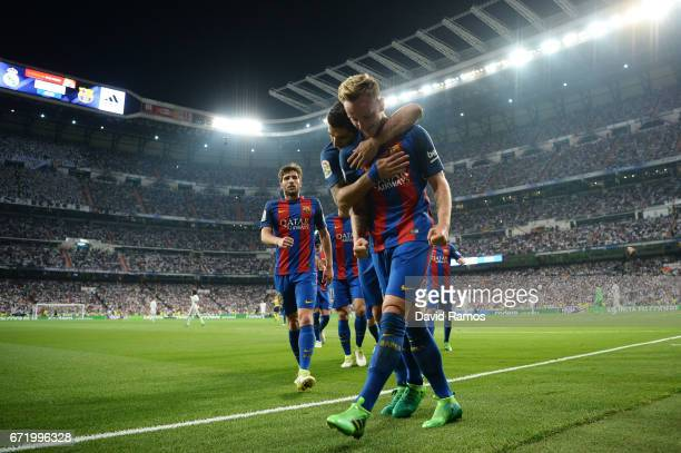 Ivan Rakitic of Barcelona celebrates as he scores their second goal with Luis Suarez during the La Liga match between Real Madrid CF and FC Barcelona...