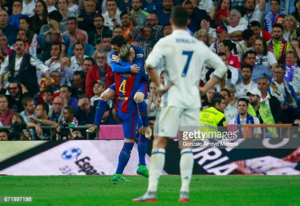 Ivan Rakitic of Barcelona celebrates as he scores their second goal with Lionel Messi of Barcelona as Cristiano Ronaldo of Real Madrid looks dejected...
