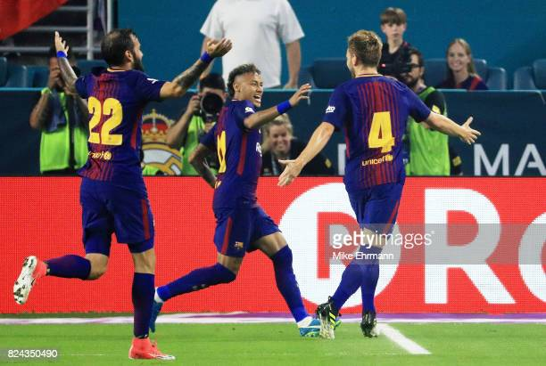 Ivan Rakitic of Barcelona celebrates his goal with teammates Neymar and Aleix Vidal in the first half against the Real Madrid during their...