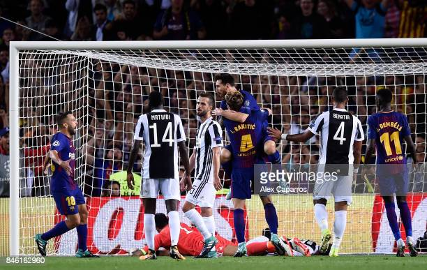 Ivan Rakitic of Barcelona celebrates scoring his sides second goal with Lionel Messi of Barcelona during the UEFA Champions League Group D match...