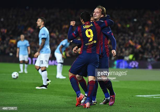 Ivan Rakitic of Barcelona celebrates scoring the opening goal with Neymar and Luis Suarez of Barcelona during the UEFA Champions League Round of 16...