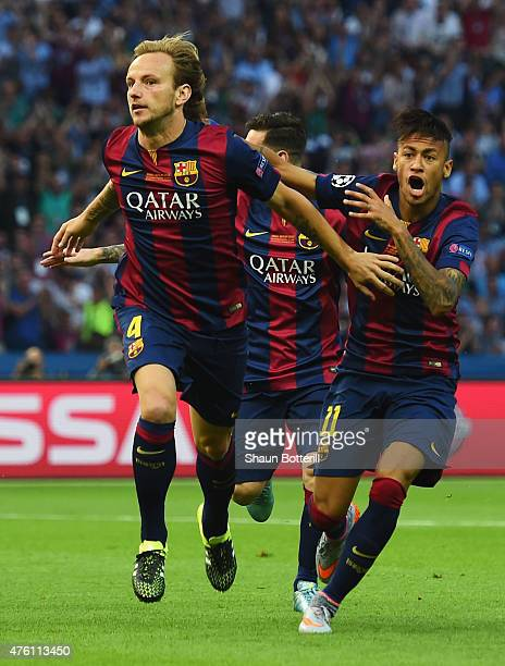 Ivan Rakitic of Barcelona celebrates scoring the opening goal with Neymar during the UEFA Champions League Final between Juventus and FC Barcelona at...