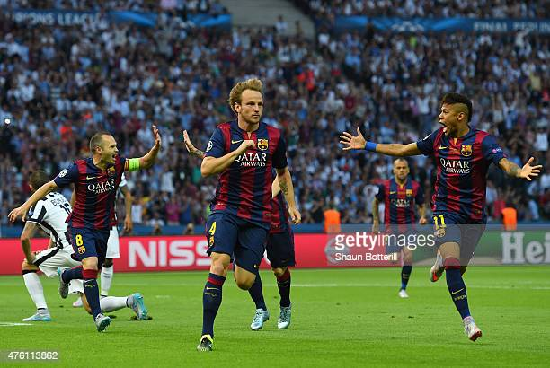 Ivan Rakitic of Barcelona celebrates scoring the opening goal with Neymar and Andres Iniesta during the UEFA Champions League Final between Juventus...