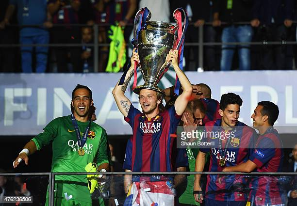 Ivan Rakitic of Barcelona celebrates victory with the trophy after the UEFA Champions League Final between Juventus and FC Barcelona at...