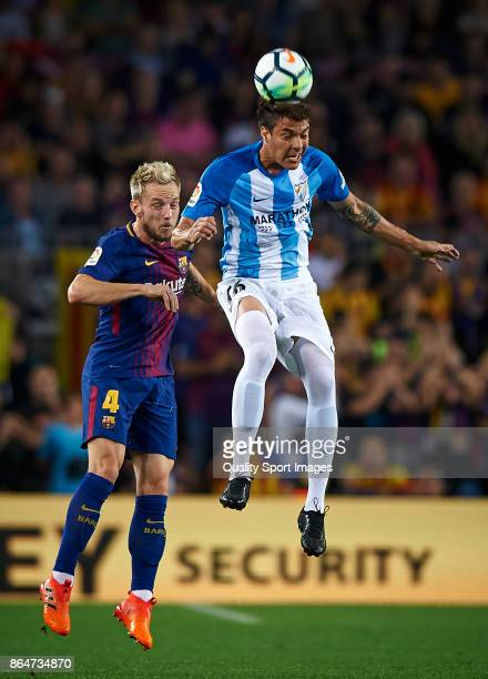 Ivan Rakitic of Barcelona competes for the ball with Adalberto Penaranda of Malaga during the La Liga match between Barcelona and Malaga at Camp Nou...