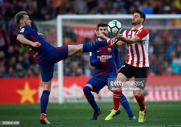 Ivan Rakitic of Barcelona competes for the ball with Aritz Aduriz of Athletic Club during the La Liga match between Barcelona and Athletic Club at...