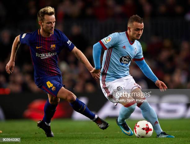 Ivan Rakitic of Barcelona competes for the ball with Lobotka of Celta during the Copa del Rey Round of 16 second Leg match between Barcelona and...