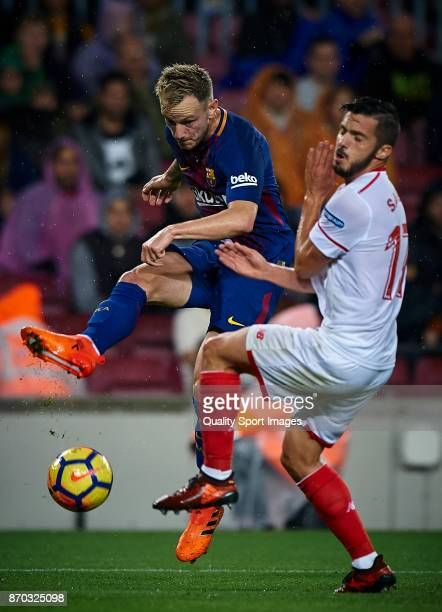 Ivan Rakitic of Barcelona competes for the ball with Pablo Sarabia of Sevilla during the La Liga match between Barcelona and Sevilla at Camp Nou on...