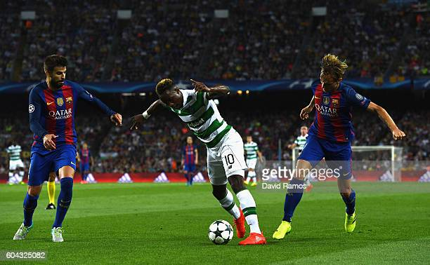 Ivan Rakitic of Barcelona foules Moussa Dembele of Celtic during the UEFA Champions League Group C match between FC Barcelona and Celtic FC at Camp...