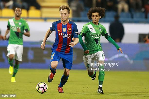 Ivan Rakitic of Barcelona in action against Omar Abdulrahman of Al-Ahli Saudi during a friendly soccer match between Al-Ahli Saudi and Barcelona at...