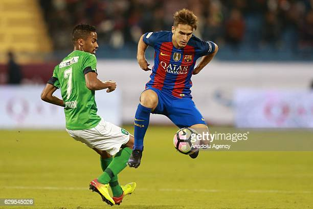 Ivan Rakitic of Barcelona in action against Salman Al-Moasher during a friendly soccer match between Al-Ahli Saudi and Barcelona at Al-Gharrafa...
