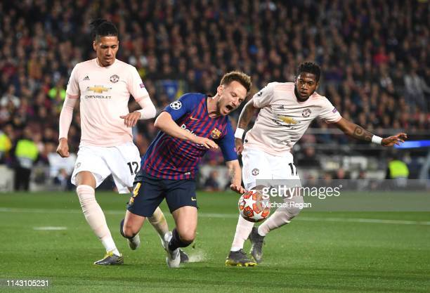 Ivan Rakitic of Barcelona is fouled by Fred of Manchester United in the penalty area during the UEFA Champions League Quarter Final second leg match...