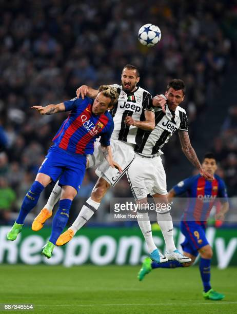 Ivan Rakitic of Barcelona jumps for the ball with Giorgio Chiellini and Mario Mandzukic of Juventus during the UEFA Champions League Quarter Final...