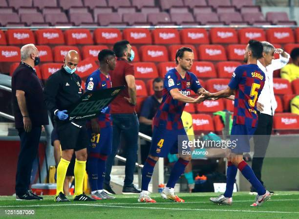 Ivan Rakitic of Barcelona replaces Sergio Busquets of Barcelona during the Liga match between FC Barcelona and Athletic Club at Camp Nou on June 23,...