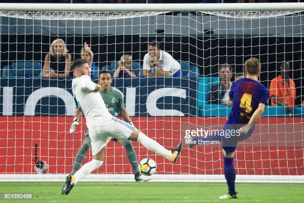 Ivan Rakitic of Barcelona scores a goal in the first half against Real Madrid during their International Champions Cup 2017 match at Hard Rock...