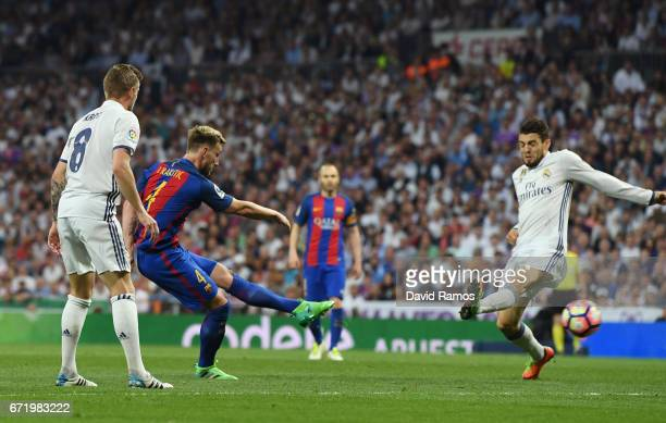 Ivan Rakitic of Barcelona scores their second goal during the La Liga match between Real Madrid CF and FC Barcelona at Estadio Bernabeu on April 23...