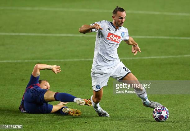 Ivan Rakitic of Barcelona tackles Fabian Ruiz of SSC Napoli during the UEFA Champions League round of 16 second leg match between FC Barcelona and...