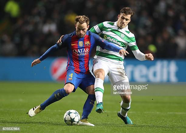 Ivan Rakitic of Barcelona vies with Erik Sviatchenko of Celtic during the UEFA Champions League match between Celtic FC and FC Barcelona at Celtic...