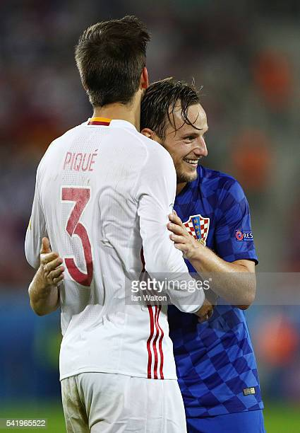 Ivan Rakitic of Croatia and Gerard Pique of Spain talk during the UEFA EURO 2016 Group D match between Croatia and Spain at Stade Matmut Atlantique...