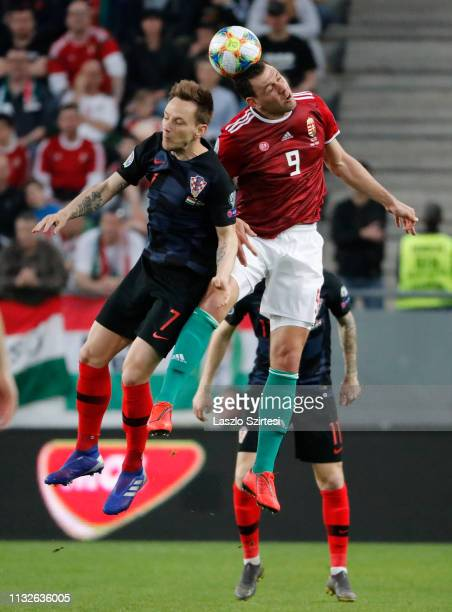 Ivan Rakitic of Croatia battles for the ball in the air with Adam Szalai of Hungary during the 2020 UEFA European Championships group E qualifying...