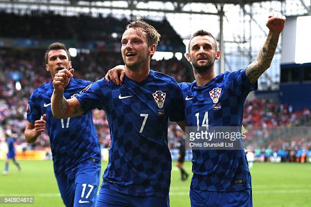 Ivan Rakitic of Croatia celebrates scoring his side's second goal with teammate Marceloe Brozovic during the UEFA Euro 2016 Group D match between the...