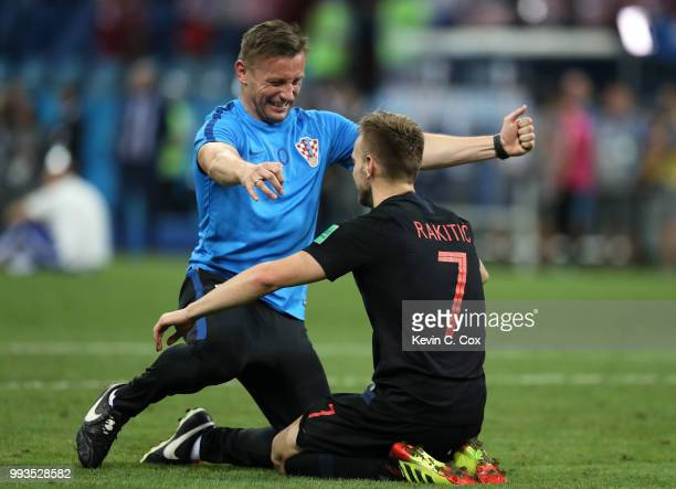 Ivan Rakitic of Croatia celebrates with a Croatia staff member following his sides victory in the 2018 FIFA World Cup Russia Quarter Final match...