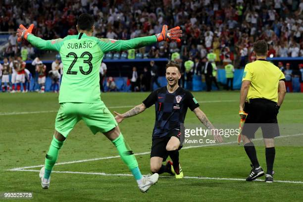 Ivan Rakitic of Croatia celebrates with Danijel Subasic of Croatia after he scores his team's fifth penalty the winning penalty in the penalty shoot...