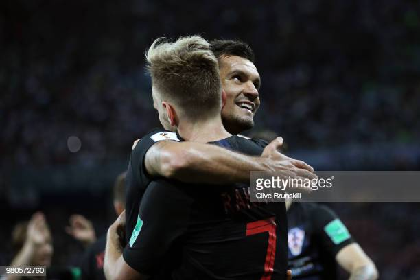 Ivan Rakitic of Croatia celebrates with teammate Dejan Lovren after scoring his team's third goal during the 2018 FIFA World Cup Russia group D match...